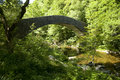 Bridge on the lyn valley watersmeet one of britain s deepest river gorges where east and hoar oak water meet at Royalty Free Stock Photo