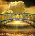 Bridge a over a body of water with the sun setting or rising Stock Image