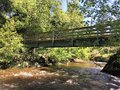 Bridge over a creek Royalty Free Stock Photo