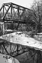 Bridge over creek old train tressel as seen from a winter Stock Image