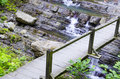 The bridge over the falls wooden mountain river Stock Photography