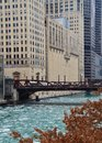 Bridge over a frozen Chicago River with ice chunks. Royalty Free Stock Photo