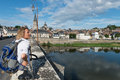 Bridge over loire with tourist in la charite suur backpack in france Royalty Free Stock Image