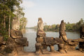 Bridge Over the Moat at the South Gate of Angkor Thom Royalty Free Stock Photo