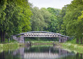 Bridge over water a canal surrounded by trees of the woods Royalty Free Stock Images