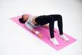 Bridge pose sporty woman doing warming up exercise Royalty Free Stock Photo
