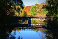 Bridge, Reflection, Fall Colors Royalty Free Stock Photo