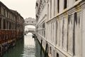 Bridge of sights venice with parked gondolas and tourists passing over the on the other side italy europe Royalty Free Stock Images