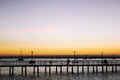 A bridge spans the bay of la paz and is silhouetted in a sunset baja peninsula mexico Royalty Free Stock Photo
