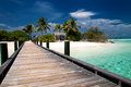 Bridge to a tropical island on the maldives Royalty Free Stock Photo