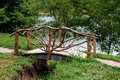The bridge from a tree with a handrail through ravine Royalty Free Stock Image