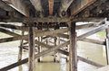 Bridge underneath an old wooden lift Royalty Free Stock Images