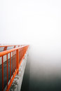 Bridge vanishing in fog point n Stock Image