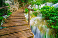 Bridge and waterfalls a wooden going over a tropical waterfall Stock Photos
