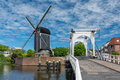 Bridge and windmill in netherlands view of a on a sunny day leiden Royalty Free Stock Photos