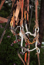 Bridle bit detail closeup of the details of a used horse and hanging among various leather straps of horse tack makes nice Royalty Free Stock Images