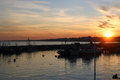 Bridlington harbour sunset from in east yorkshire with still water fishing boats and birds Royalty Free Stock Images