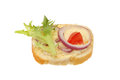 Brie canape of cheese red onion tomato and lettuce on a slice of bread Stock Photo
