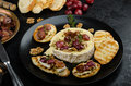 Brie cheese baked with nuts and grapes Royalty Free Stock Photo
