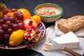 Brie cheese with bread and fruits grain nuts on dark surface Royalty Free Stock Photo