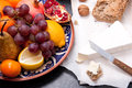 Brie cheese with bread and fruits grain nuts on dark surface Stock Photography