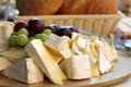 Brie cheese on cutting board Royalty Free Stock Photos