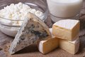 Brie cheese, Dor Blue, cottage cheese and milk close up Royalty Free Stock Photo