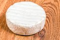 Brie cheese a head of on wooden surface Royalty Free Stock Photography