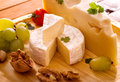 Brie cheese mix on wooden plate still life Stock Images