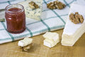 Brie cheese with nuts and jam