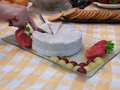 Brie cheese plate  with strawberry and grapes Royalty Free Stock Photo
