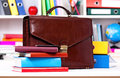 Briefcase brown leather and books on table at office Royalty Free Stock Photography