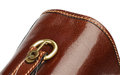 Briefcase details handle of brown leather closeup with gold and little key on white background Royalty Free Stock Photography