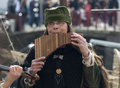 Woman playing panflute Royalty Free Stock Photo