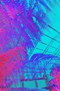 Bright, abstract, colourful background with pink tropical palms. Royalty Free Stock Photo