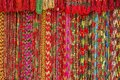 Bright background of handmade strands of colorful beads at outdoor crafts market in Kathmandu, Nepal. Royalty Free Stock Photo