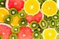 Bright background with kiwi fruit, grapefruit and oranges Royalty Free Stock Photo