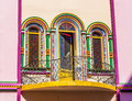 Bright balcony colorful in fairy tale style with arched windows Royalty Free Stock Images