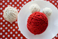 Bright balls on a polka dot background of yarn Stock Images