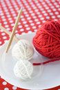 Bright balls of yarn and knitting needles on a polka dot background Royalty Free Stock Photography