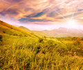Bright beautiful sunset with rays of the sun in a mountain valle Royalty Free Stock Photo