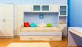 Bright bedroom with a bed and cupboard pillows Stock Photos