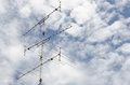 Bright blue sky antenna tower under Stock Photography