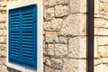 Bright Blue Vintage Window Shutters on Corners of Stone Building Royalty Free Stock Photo