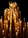 Bright candles lighted up in the completely dark Royalty Free Stock Photo
