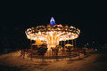 Bright carousel at dark night in winter Royalty Free Stock Photo