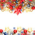 Bright Christmas card composition with red holly berries, Xmas tree branch, gold garland isolated on white background. Royalty Free Stock Photo