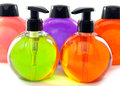 Bright color cosmetic small bottles with the dispenser Royalty Free Stock Photos