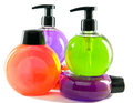 Bright color cosmetic small bottles with the dispenser Stock Images