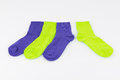 Bright colored socks light green and purple on white background Stock Photo